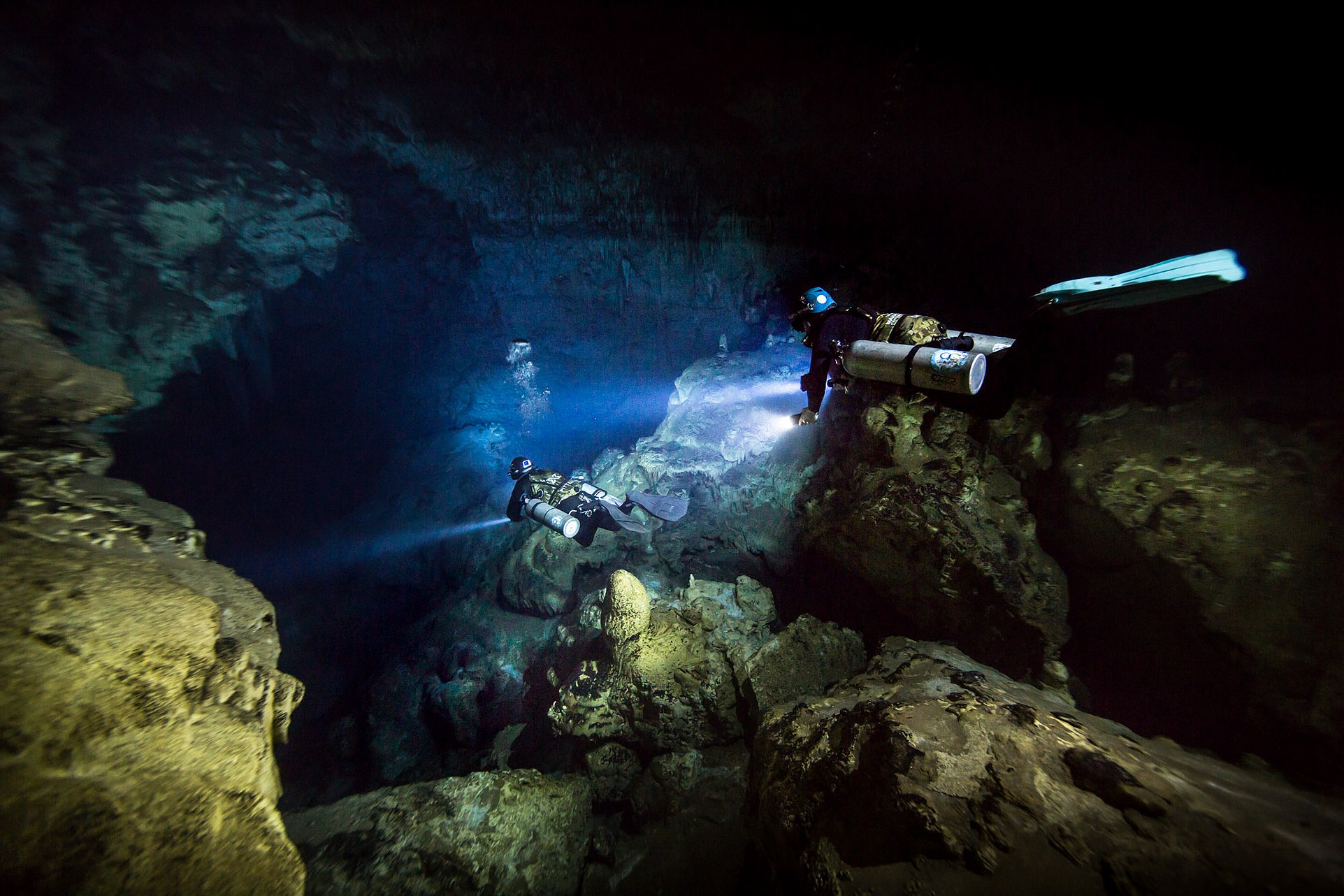 Divers descending into Vintany cave in Madagascar