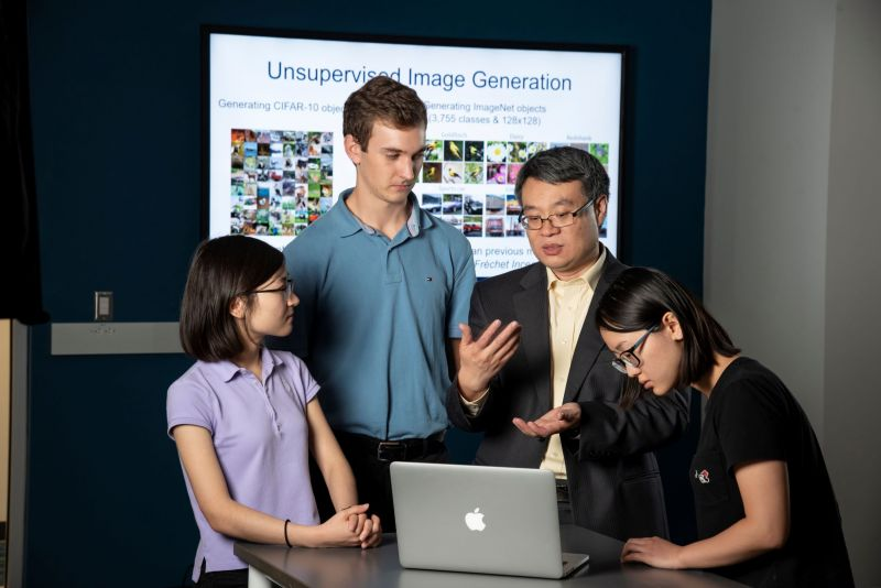Duke researcher and students