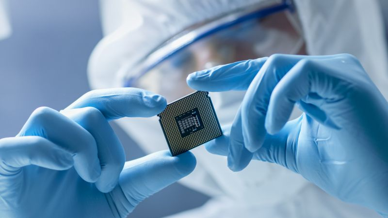 Scientists holding semiconductor