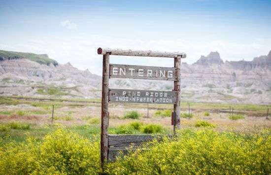 Sign that reads Entering Pine Ridge Indian Reservation